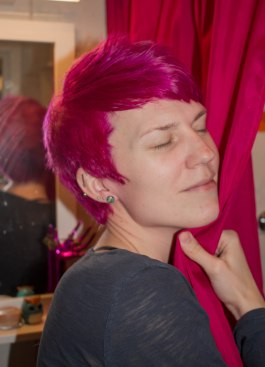 Pink/red hair.